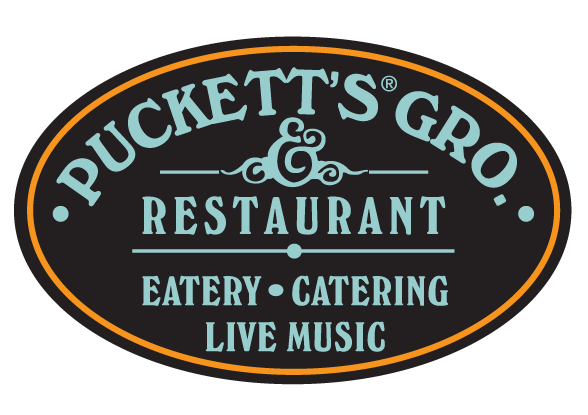 Puckett's Gro. & Restaurant Oval logo with black, blue and orange accents