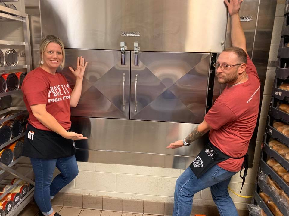 Puckett's servers show off the new smoker in Pigeon Forge